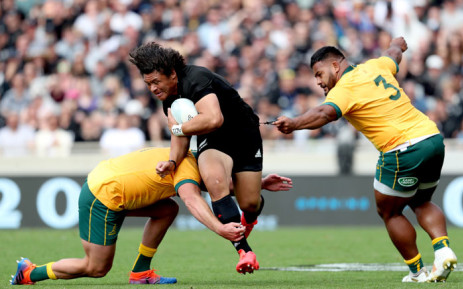 Australia's James Slipper (L) and Taniela Tupou (R) tackle New Zealand's Caleb Clarke during the second Bledisloe Cup rugby union match between New Zealand and Australia in Auckland on 18 October 2020. Picture: AFP