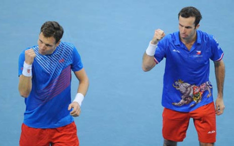 Czech Republic's d Tomas Berdych (L) and Radek Stepanek (R) celebrate their victory after their Davis Cup final doubles match against Serbian Nenad Zimonjic and Ilija Bozoljac at the Kombank Arena in Belgrade on November 16, 2013. Picture:AFP