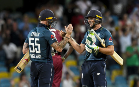 Ben Stokes (L) and Jos Buttler (R) of England celebrate winning the 1st ODI between West Indies and England at Kensington Oval, Bridgetown, Barbados, on 20 February 2019. Picture: AFP