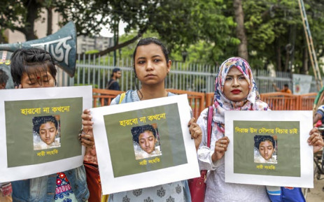In this photo taken on 12 April 2019 Bangladeshi women hold placards and photographs of schoolgirl Nusrat Jahan Rafi at a protest in Dhaka, following her murder by being set on fire after she had reported a sexual assault. Picture: AFP.