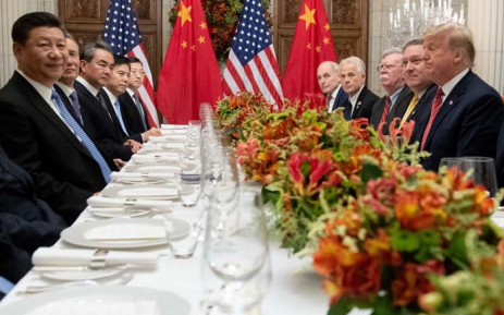 US President Donald Trump (R) and China's President Xi Jinping (L) along with members of their delegations, hold a dinner meeting at the end of the G20 Leaders' Summit in Buenos Aires, on 1 December 2018. Picture: AFP