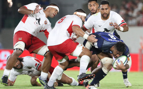Ananaki Lelei Mafi of Japan (R) attempts to run past Tonga's players during the Pacific Nations Cup rugby union match between Japan and Tonga at Hanazono stadium in Higashiosaka, Osaka prefecture on 3 August 2019. Picture: AFP