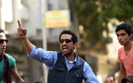 An Egyptian protester shouts slogans during a demonstration against a controversial deal to hand two islands in the Red Sea to Saudi Arabia on 15 April 2016 outside the Journalists' Syndicate in central Cairo. Picture: AFP.