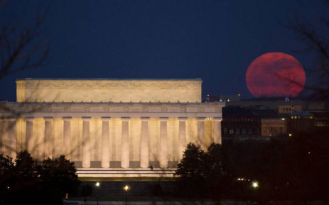 FILE: The full moon is seen as it rises near the Lincoln Memorial, Saturday, 19 March 2011, in Washington. Picture: Nasa/Bill Ingalls