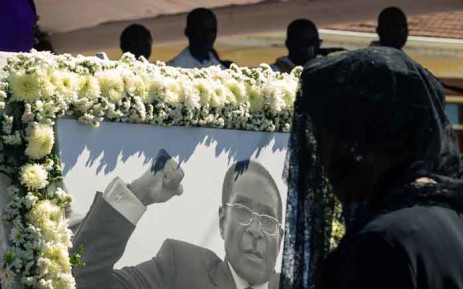 FILE: Former first lady Grace Mugabe walks past a portrait of Robert Mugabe during the burial of the former Zimbabwe leader at his home village in Kutama, on 28 September 2019. Picture: AFP