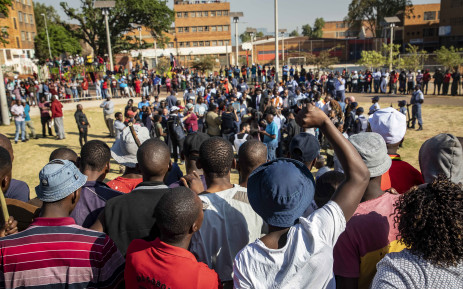 FILE: Zulu hostel dwellers in Jeppestown cheer against Min Cele. They did not accept his conditions. Picture: Thomas Holder/EWN.