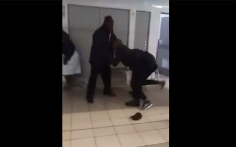 A screengrab of Tlotlo Ntehelang being pulled away by security guards at the Mamelodi Day Hospital.