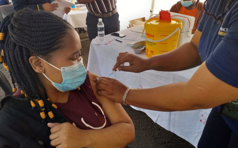 Nomvelo Radebe (22) from Soweto just received her jab at Bara Taxi Rank on 20 August 2021. All public vaccination sites in Gauteng accept walk-ins whether people are registered on the EVDS or not. Picture: @GautengHealth/Twitter.
