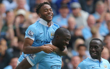 FILE: FILE: Manchester City's Raheem Sterling and teammate Yaya Toure celebrate a goal. Picture: Manchester City/Facebook page.