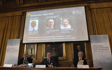 The Nobel jury (seated) announces David J Thouless, F Duncan M Haldane and J Michael Kosterlitz as the winners of the 2016 Nobel Prize in Physics. Picture: AFP.