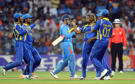 FILE: Sri Lanka bowler Lasith Malinga (3R) celebrates the wicket of India batsman Virendra Sehwag (C) with teammates during the final match of the ICC Cricket World Cup 2011 between India and Sri Lanka at The Wankhede Stadium in Mumbai on 2 April 2011. Picture: AFP