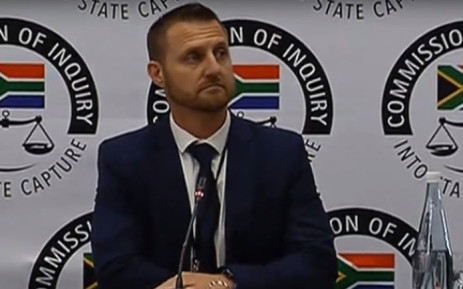 A  screengrab of former SIU lead investigator Clint Oellermann giving evidence at the Zondo Commission on 1 April 2019.