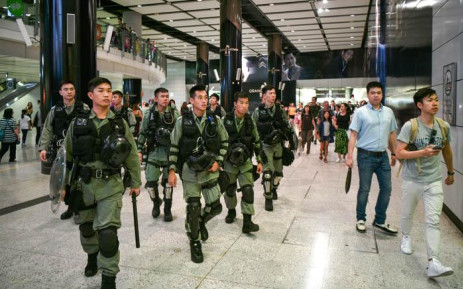Riot police patrol the Hong Kong MTR underground metro station in Hong Kong on September 7, 2019. Hong Kong's pro-democracy protesters were planning to disrupt transport links to the airport on September 7 in their first mass mobilisation since the city's leader made a surprise concession earlier this week. AFP