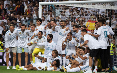 Real Madrid's players pose as they celebrate their Supercup after winning the second leg of the Spanish Supercup football match Real Madrid vs FC Barcelona at the Santiago Bernabeu stadium in Madrid, on 16 August, 2017. Picture: AFP.