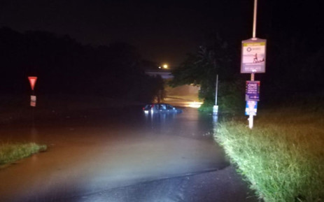 An SUV is partially submerged in flood water on the onramp onto the M4 N/ Riverside offramp in Durban North on 23 April 2019. Picture: @Netcare911_sa/Twitter