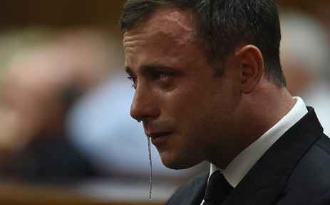 An emotional Oscar Pistorius is seen in the dock as judgment is handed down in his murder trial at the High Court in Pretoria. Picture: AFP.