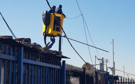 City Power workers fix overhead power cables at a sub-station in Alexandra on 3 July 2019. Picture: @CityPowerJhb/Twitter