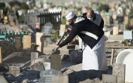 Two men fill in a grave after the funeral of a man who died of COVID-19 coronavirus for a Muslim burial at the Klip Road Cemetery in Grassy Park, Cape Town, on 9 June 2020. Picture: AFP