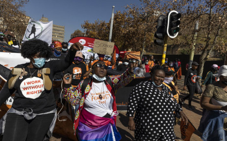 Sex workers and supporters shout and sing slogans during a march in solidarity with sex workers set on decriminalising the trade in Johannesburg on May 27, 2021. Picturre: Guillem Sartorio/AFP