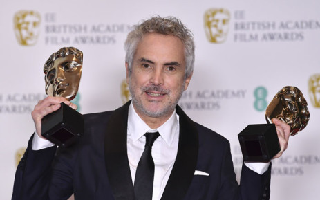 Mexican director Alfonso Cuaron poses with the awards for a Director and for Best Film for 'Roma' at the Bafta British Academy Film Awards at the Royal Albert Hall in London on 10 February 2019. Picture: AFP