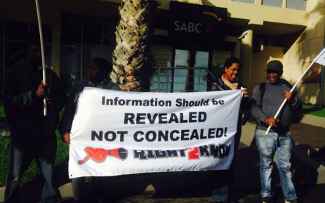 Members of The Right to Know Campaign gathered in front of a SABC building in Sea Point. Picture: Shamiela Fisher/EWN.