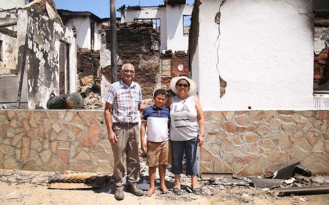 Wupperthal residents Johannes and Daphne Salomo stand in front of the remains of their home. The house was built by Johannes father nearly a hundred years ago. Picture: Bertram Malgas/EWN