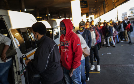 Commuters wait to enter their taxi at Bree taxi rank in Johannesburg. Picture: AFP