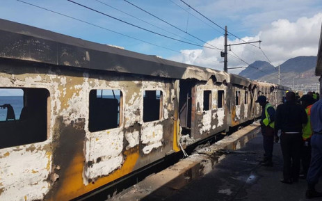 Officials assess the damage of a train fire at Glencairn station on 7 October 2019. Picture: 1 Second Alerts