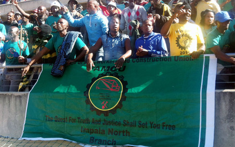 Amcu members sing and dance at the Royal Bafokeng Stadium in Rustenburg ahead of the briefing by union leader Joseph Mathunjwa on 23 June 2014. Picture: Reinart Toerien/EWN.