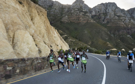 Runners on Chapman's Peak as they compete in the Two Oceans ultra-marathon, on 31 March 2018, in Cape Town. Picture: AFP