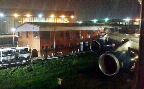 The British Airways plane reportedly hit its wing into a building at OR Tambo International. Picture: @HarrietTolputt via Twitter.