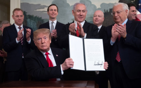 US President Donald Trump holds up a signed Proclamation on the Golan Heights alongside Israeli Prime Minister Benjamin Netanyahu in the Diplomatic Reception Room at the White House in Washington, DC, 25 March 2019. Picture: AFP