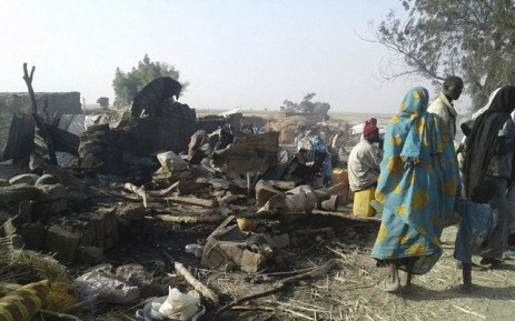 FILE: This handout image from Doctors Without Border (MSF) shows people standing next to destruction after an air force jet accidentally bombarded a camp for those displaced by Boko Haram Islamists, in Rann, northeast Nigeria. Picture: AFP