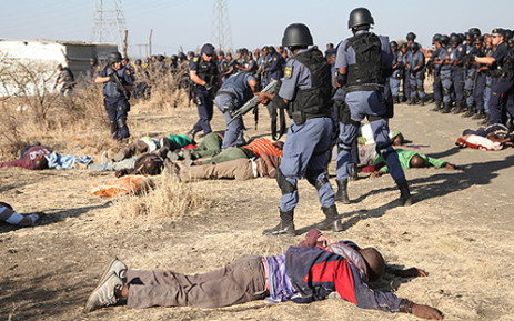 FILE: Police open fire at protesting workers at the Lonmin mine in Marikana on 16 August 2012. Picture: EWN.