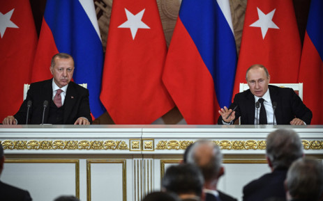 Russian President Vladimir Putin (R) speaks past Turkish President Recep Tayyip Erdogan during their joint press conference at the Kremlin in Moscow on 8 April 2019. Picture: AFP