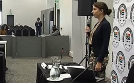 A screengrab of Treasury economist Catherine MacLeod being sworn in at the Zondo commission of inquiry into state capture.