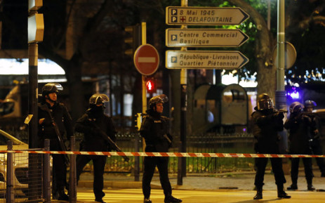 The shots were fired during early morning counter-terror raids in the suburb of Saint-Denis. AFP.