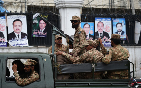 Pakistani soldiers patrol outside a voting material distribution centre in Lahore on 24 July, 2018. Pakistan will hold its general election on 25 July. Picture: AFP