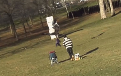 This screenshot, taken from a video with 3D animations, shows a fake eagle picking up a computer-generated baby in a park in Montreal, Canada.