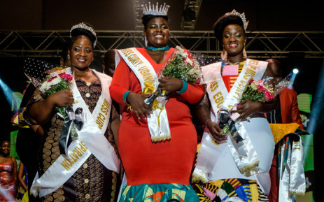 Nasasi Belinda (C), a business woman, poses as she is crowned Miss Curvy Uganda during the first edition of Miss Curvy Uganda in Kampala, Uganda, on April 26, 2019. Picture: AFP.