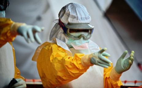 An MSF medical worker, wearing protective clothing at an MSF Ebola treatment facility in Kailahun, on 15 August 2014. Picture: AFP.