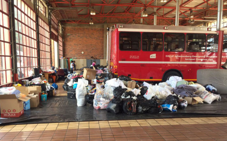 Bags and boxes full of clothing, food, blankets, toiletries and dishes have filled up four engine bays at the Sandton Fire Station. Picture: Ahmed Kajee/EWN