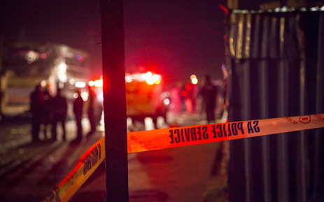 FILE: Red emergency personnel lights catch police tape at the scene of a crime. Picture: Thomas Holder/EWN.