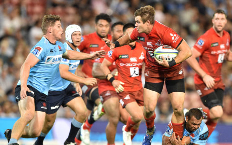 Sunwolves player Gerhard Van Den Heever (3rd R) is tackled by Waratahs player Michael Hooper (L) and Kurtley Beale (bottom, 2nd R) during the Super Rugby match between Australia's Waratahs and Japan's Sunwolves in Newcastle on 29 March 2019. Picture: AFP