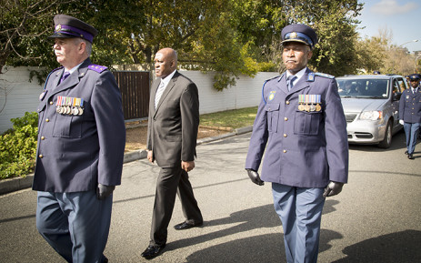 Major-General Thembesile Patekile marches in front of the hearse carrying Warrant Officer Holz's body. Picture: Thomas Holder/EWN
