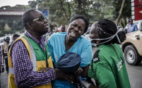 A woman reacts as she leaves the scene of an explosion at a hotel complex in Nairobi's Westlands suburb on 15 January 2019, in Kenya. Picture: AFP