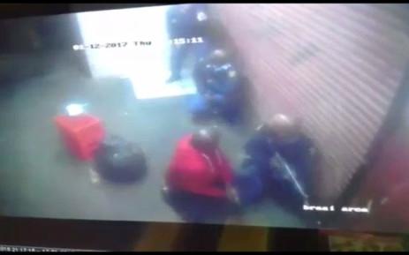 FILE: A screengrab of police responding to a robbery at a Katlehong petrol station.