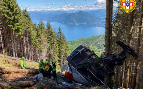 A photo taken and handout on 23 May 2021 by The Italian National Alpine and Speleological Rescue Corps shows a cable car that crashed to the ground in the resort town of Stresa on the shores of Lake Maggiore in the Piedmont region. Picture: Corpo Nazionale Soccorso Alpino e Speleologico/AFP