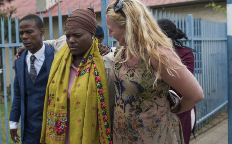 """Pastor Paseka """"Mboro"""" Motsoeneng  arrives at the Alberton Police Station with the mother of the child who had died at his church in Katlehong on Sunday. Mboro had opened up a case of culpable homicide against the paramedics involved. Picture: Ihsaan Haffejee/EWN"""