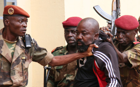 "In this file photo taken on 29 October 2018, members of the armed forces arrest Central African MP Alfred Yekatom aka ""Rambo"" (C), who represents the southern M'baiki district former militia leader, after he fired the gun at the parliament in Bangui. Picture: AFP."